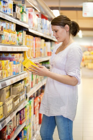 woman-holding-package-in-grocery-store