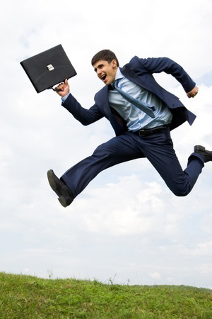 young-man-in-suit-jumping