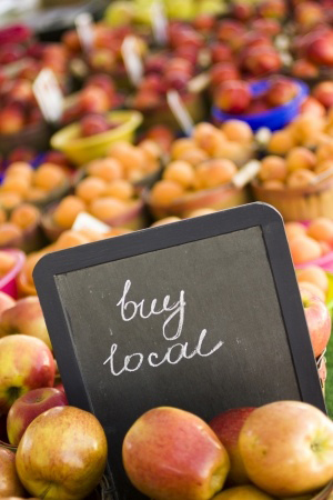 buy-local-sign-in-front-of-fruit