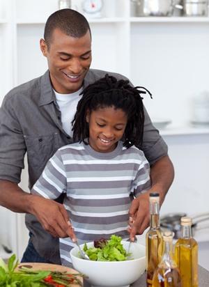 boy-and-father-preparing-salad