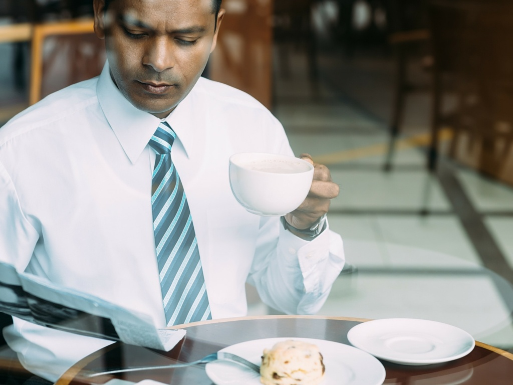 Business man eating breakfast at a new Fast Casual concept